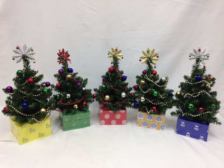 We have made decorated trees with customized Tree Boxes for each Dragon. #CBCDragonsDen