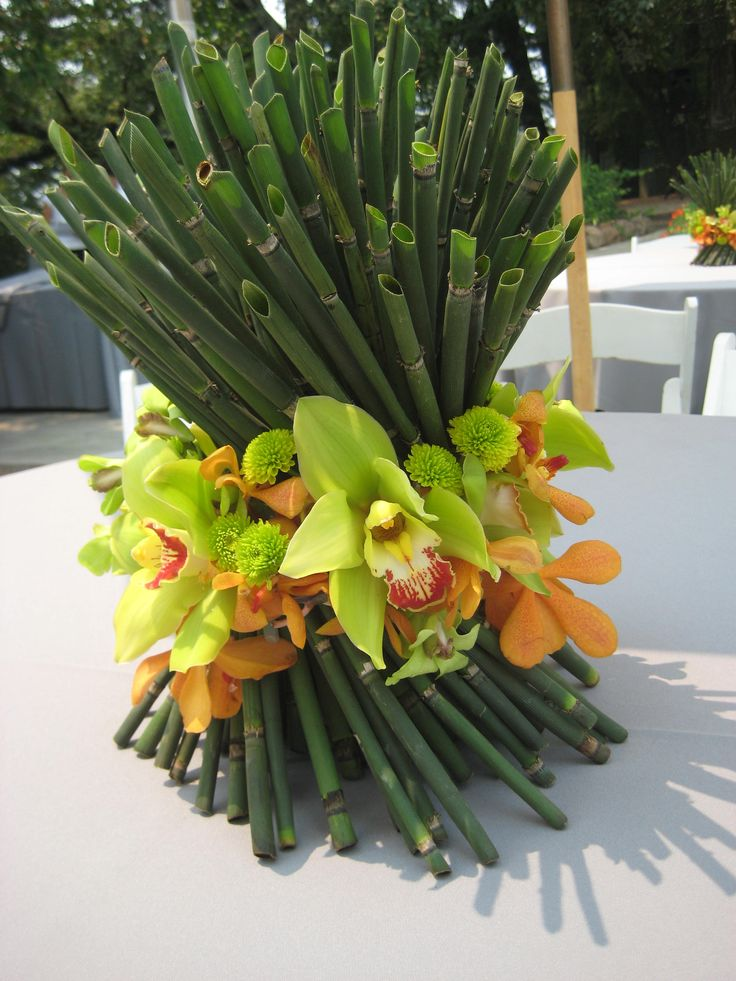 Tropical wedding centerpieces, could use different flowers to keep cost down!