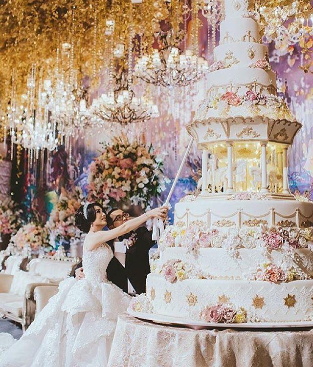 Taking fantasy weddings to a whole new level, isn't this totally out of this world!..  Gown @meltatan |  Venue @ritzcarlton Jakarta | ✨ Stylists @kenisha_wo |  @lenovellecake |  Bouquet @thecoppelia | ⚡️ Lighting @lumens_indo |  MU @andreaszhu |  @lvcasedo✨✨ ... #FantasyWedding ...