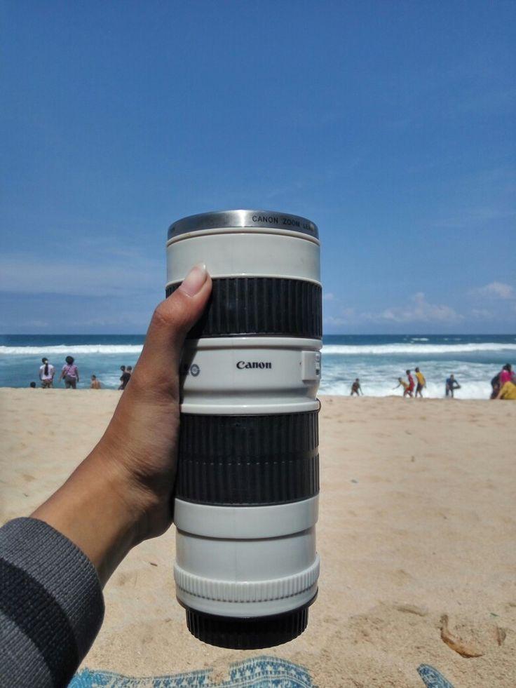 Tumbler lensa canon