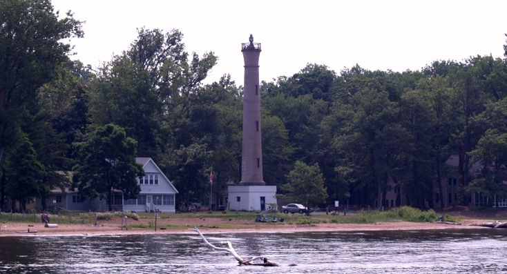Seen on this gray hazy day in the summer of 2006, is the Verona Beach Lighthouse. It was built in 1915 when the Erie Barge Canal was opened. It is located on the east end of Oneida Lake at the entrance to the Erie Canal near the popular port of Sylvan Beach, Oneida Lake, NY