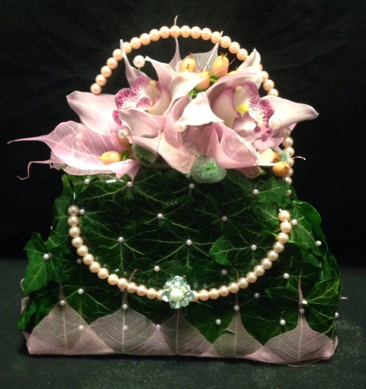Bag made from ivy leaves and orchids