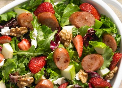 Give your taste buds a sweet ride with this light, refreshing salad! This Johnsonville® Strawberry and Apple Chicken Sausage Salad is the perfect mix of mixed greens, strawberries, Granny Smith apples, walnuts, feta cheese and Johnsonville Apple Chicken Sausage! A light dressing made of cider vinegar, honey and canola oil make this a guaranteed hit for a pot luck lunch! #LowCarb
