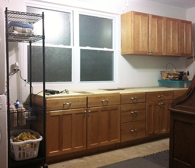 Reuse old kitchen cabinets in garage to create a workbench