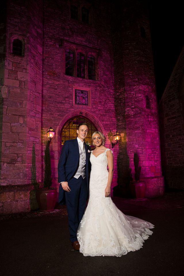 Bride & Groom at Marriott St Pierre, Chepstow #wedding #weddingphotography #Bathphotographer #bride #bridal #groom #couple #castle #gels #purple
