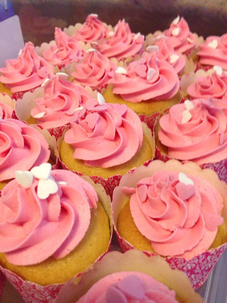 Vanilla cupcakes decorated with Light Pink buttercream topped with sugar hearts