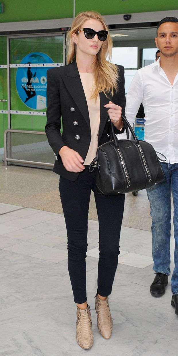 Rosie Huntington-Whiteley looks so chic in this #travel outfit. A great look if you have to go from airport to office! // Wearing a Balmain blazer, Dolce & Gabbana sunglasses, Frame Denim skinny jeans, Givenchy small Lucrezia Duffel, and Saint Laurent boots.