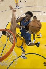Minnesota Timberwolves guard Andrew Wiggins (22) shoots the basketball against Golden State Warriors center Andrew Bogut (12) during the second half at Oracle Arena. The Timberwolves defeated the Warriors 124-117.  #9233392