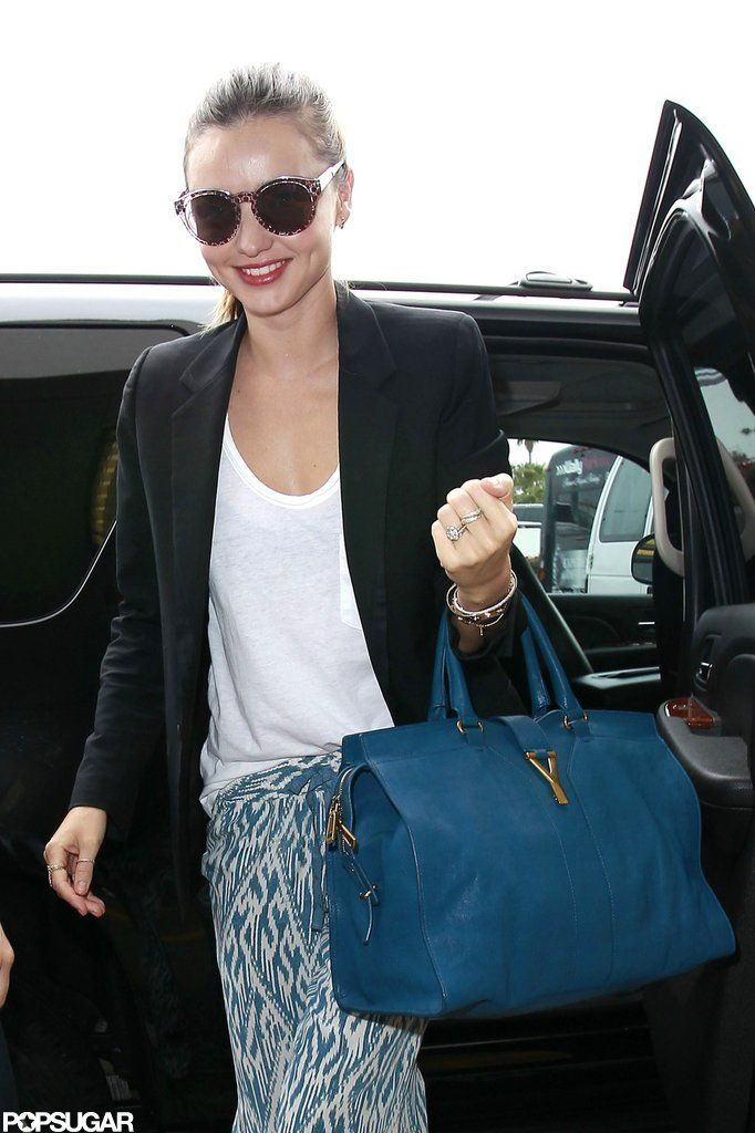 Miranda Kerr Heads Out on Her Latest Trip   Michael Kors Outlet ...