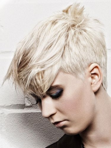 Great edgy short cut, undercut through the side maintaining length on top, enhanced by working a cool ash blonde to bring out the texture