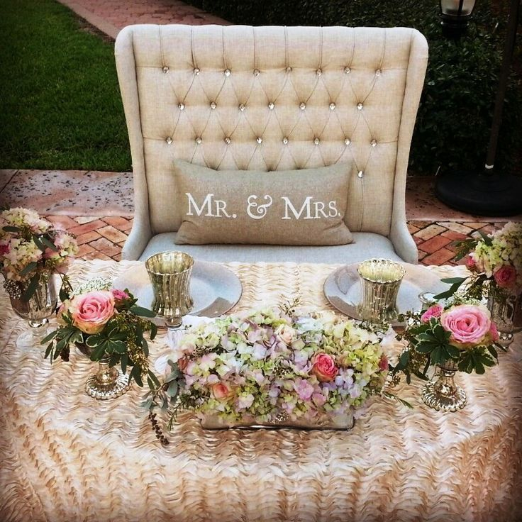 Cute idea to have bride & groom sit in one of our love seats for sweetheart table | Crystal and Crates Vintage Rentals