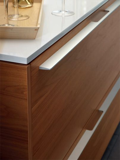 SANTOS kitchen | Contemporary proposals for classical environments. Fronts with walnut finish and aluminium handle.