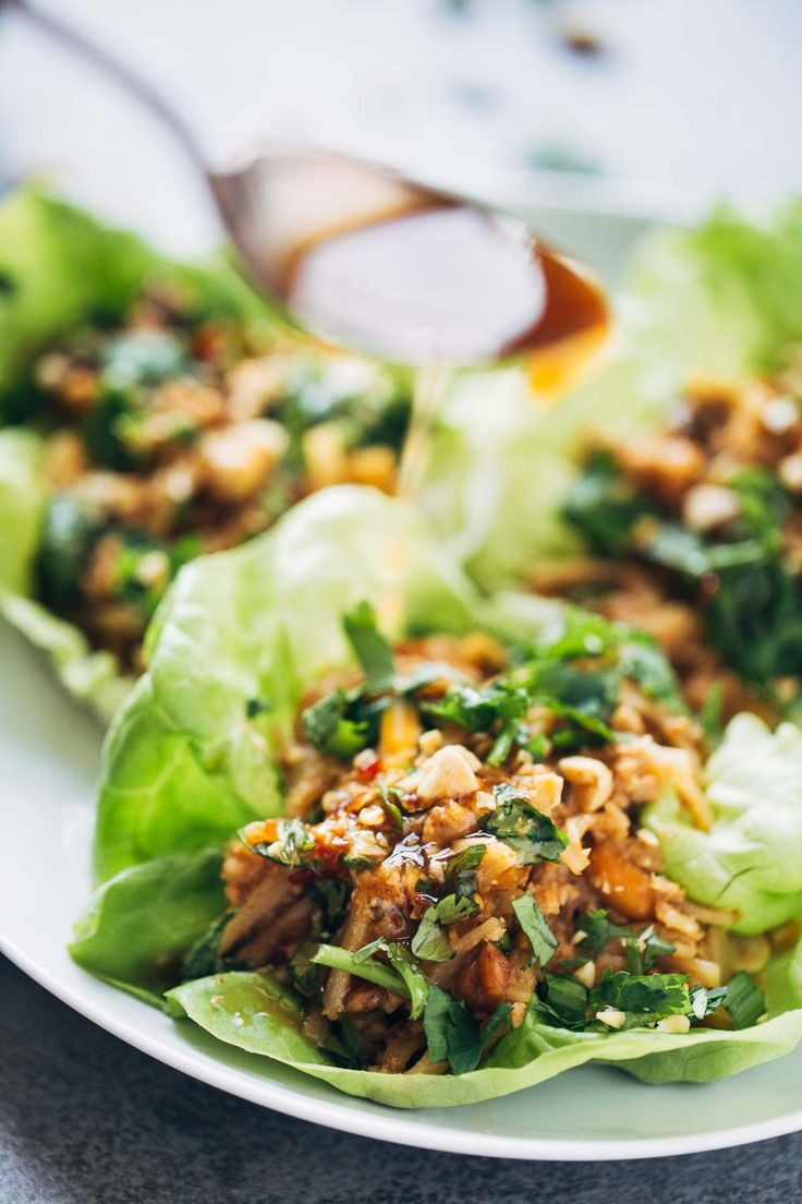 Peanut Chicken Lettuce Wraps with Garlic Ginger Sauce - made from scratch and ready in 20 minutes. SO yummy!