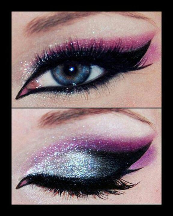 Shiny baby blue on eye lid - Pink on side - Eye liner going out thick outlining blue half way at top - Thick mascara