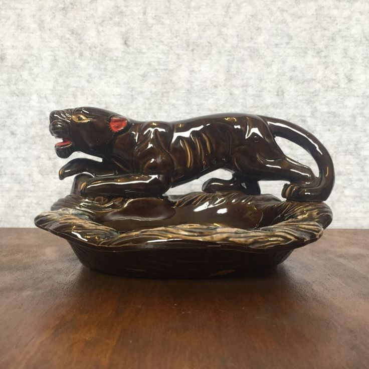 VINTAGE JAPANESE CERAMIC PANTHER DISH - $30 AUD  Made in Japan circa 1970s, this ceramic dish with prowling panther is in great vintage condition with no chips, cracks or crazing.  Good for your soap, candy… or even as an ash tray.
