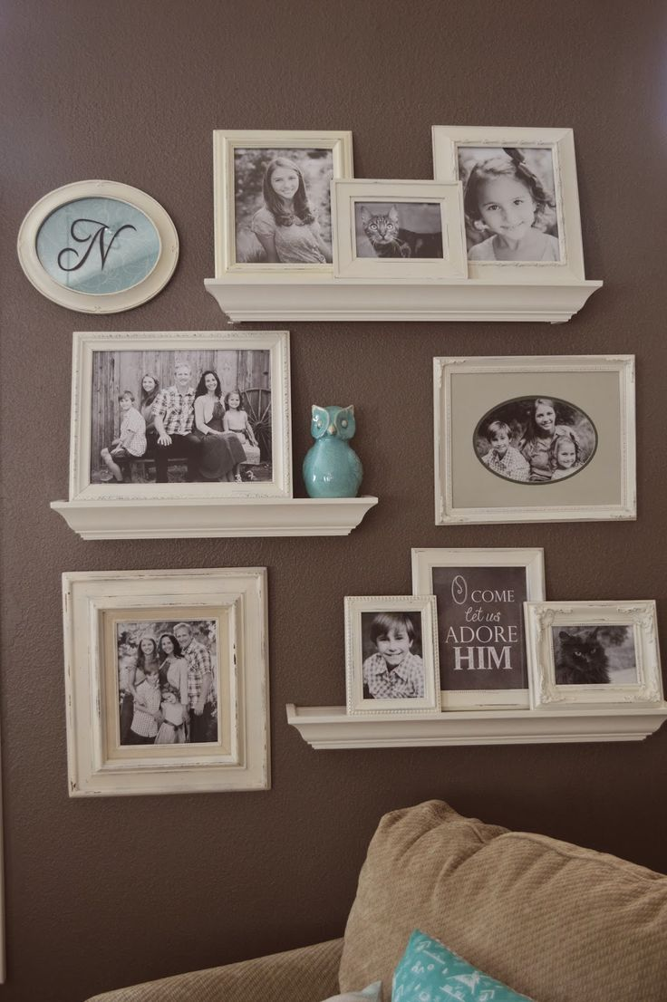 Idea: ONE framed pic per shelf, with 1 or 2 vases/figurines/etc. beside it!