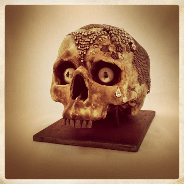 ceramic skull, silver chainmail, resin eyes containing flies, metal stand - all hand made by TheBlackEnglishman