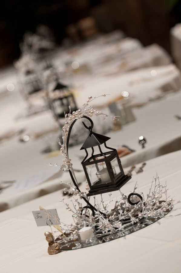 winter wedding centerpieces- put on wood instead of mirror, the lantern is fun