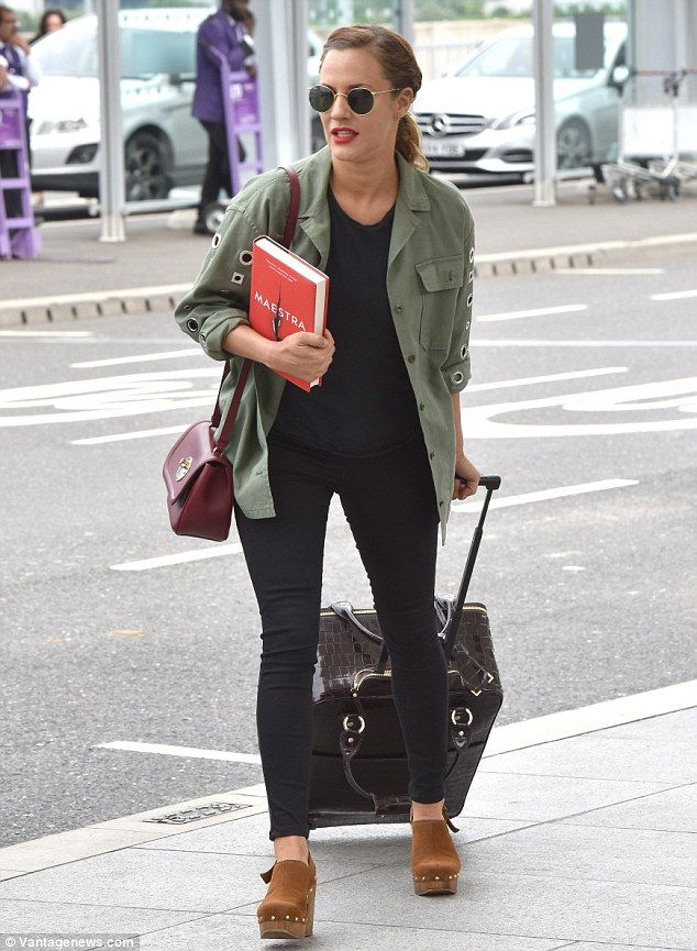 Jet-setter: Caroline Flack looked ready for action as she headed to London's Heathrow Airport before jetting off to film the next installment of Love Island on Friday