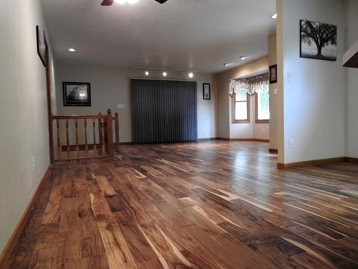 """We had the entire upstairs installed with our new flooring. It is beyond what we expected."" - Becki, KS [Acacia Handscraped Hardwood]"