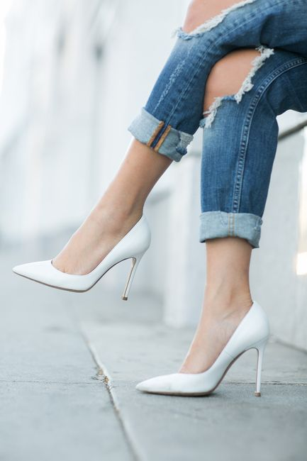 ripped knees, white pumps