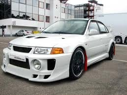 1998 Mitsubishi Evo 5......300hp and 275 ft.lbs. torque......crazy.....