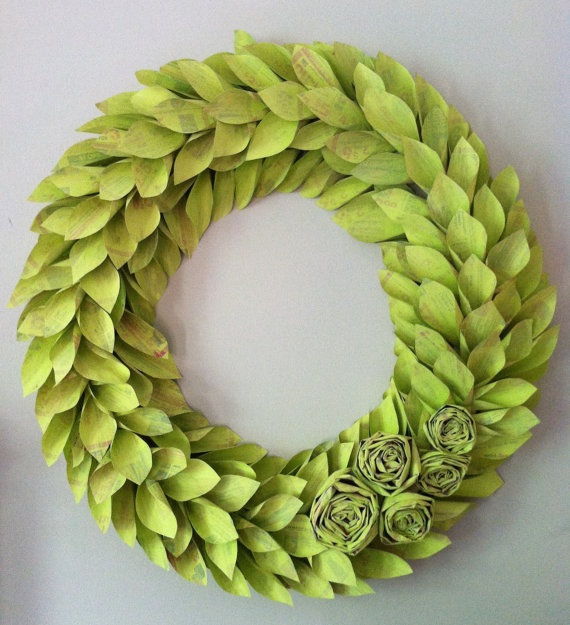 wreath made of newspapers -- awesome way to recycle - also could make out of plastic spoons like that mirror idea.