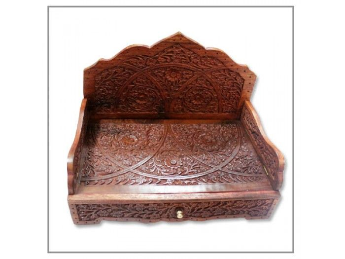Long Sinhasan, Buy Throne online from India, VedicVaani.com. Deity thrones, wooden singhasan, sinhasana hand carving on wood, idols are installed on thrones. The bottom part has an openable container which can hold incense sticks, kumkum and other puja items   Make: Wood  Outside Dimensions:  9.75 inches (H ) x 13.25 inches (L) x 8.5 inches (W)  Inside Dimensions:  7.5 inches (H) x 12 inches (L) x 7.5 inches (W) Weight: 2.1 kgs app