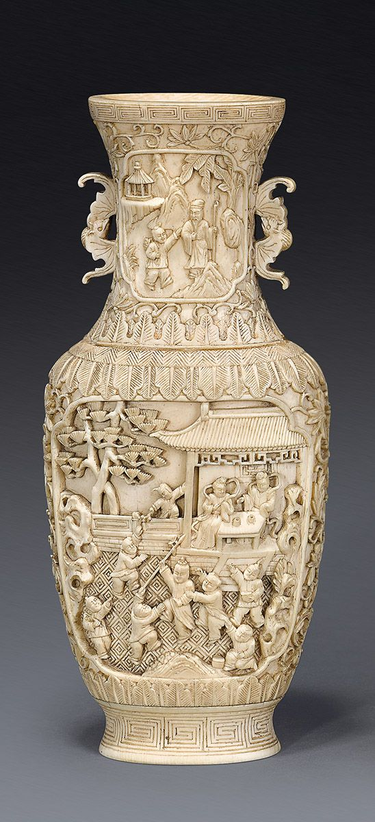 An ivory vase Qing dynasty, 19th century  of oval section carved in undercut relief with panels depicting two figures seated in a garden pavilion watching boys at play, reserved on a ground of floral scrolls between bands of stiff leaves and key fret, the waisted neck with two bat handles 17 cm high