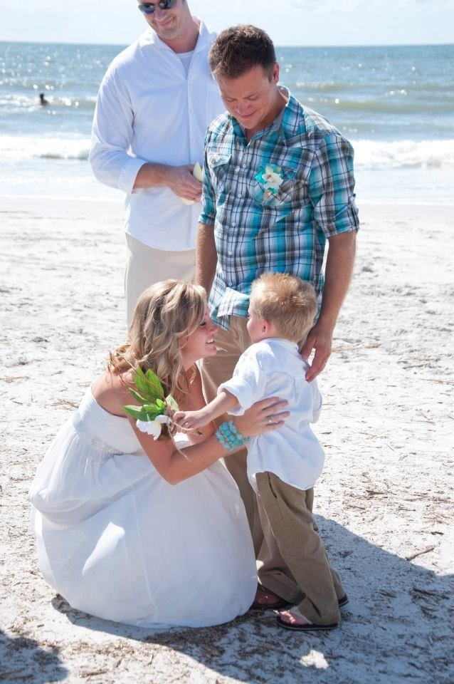 Simple beach wedding but so beautiful & done on a budget.