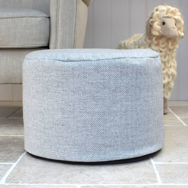 Grey Herringbone Wool Foot PouffeGorgeous British made foot pouffe, these foot pouffe are covered in 100% wool, and filled with 100% polyester beads. The cover has a zip finish and can be removed and machine washable. Grey 100% wool fabric in a herringbone pattern. The base of the foot pouffe has a suede effect bottom. Not suitable for sitting on.Wool & PolyesterH: 28 cm W: 45 cm