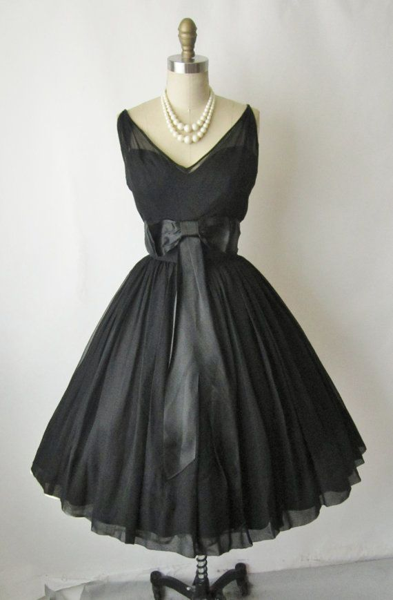 Vintage 1950s little black dress with bow.