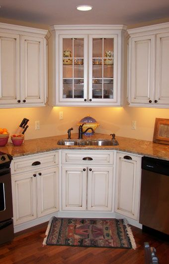 white cabinets with dark bronze hardware | white in the cabinets allows the  dark bronze fixtures. Corner Sink KitchenKitchen ...