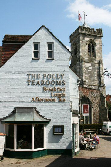 'The Polly Tearooms' in Salisbury, Wiltshire. Net curtains, stainless steel teapots, doilies and a cake counter ~ 'The Polly' is a traditional English Tearoom, a pleasant place for an afternoon cuppa (with fresh cake, naturally) both inside or on a terrace beside St Thomas's church.
