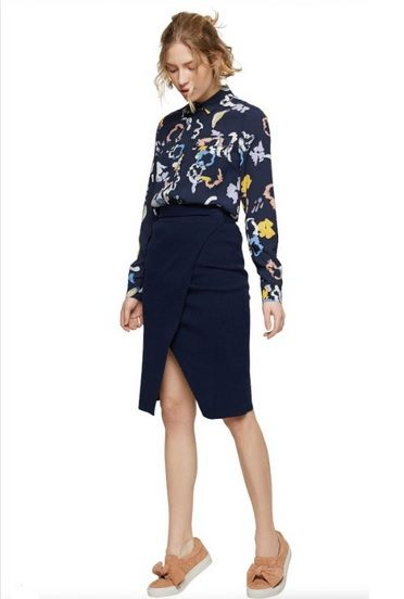 Navy printed blouse+navy wrap knee-length skirt+blush bow sneakers. Spring Casual Outfit 2017