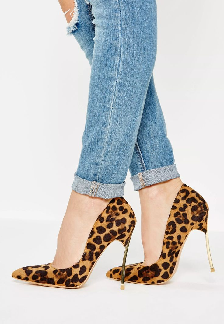 Channel your inner feline and step out in style with these brown animal print court shoes.