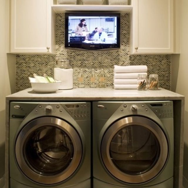 This home owner has got it set in this very cool Laundry Room featuring a hidden flat screen TV.