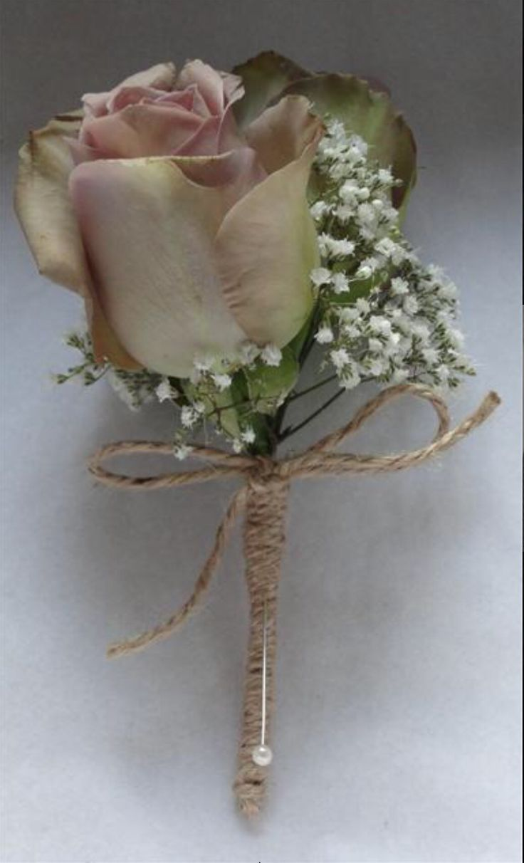 String and coloured rose