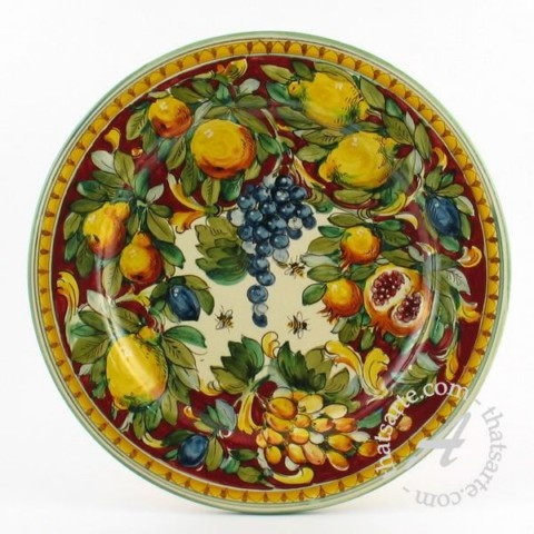 Italian plate - Toscana Rosso - Many of the styles currently produced date back to the renaissance and earlier. Not only do they have historical significance, they are pieces of beauty. Tuscan designs evoke a sense of the fertile Italian countryside, with lush fruits, leaves, and insects. Other traditional majolica styles have strong ties to renaissance art, depicting the mythical beasts from the frescos of Raphael.
