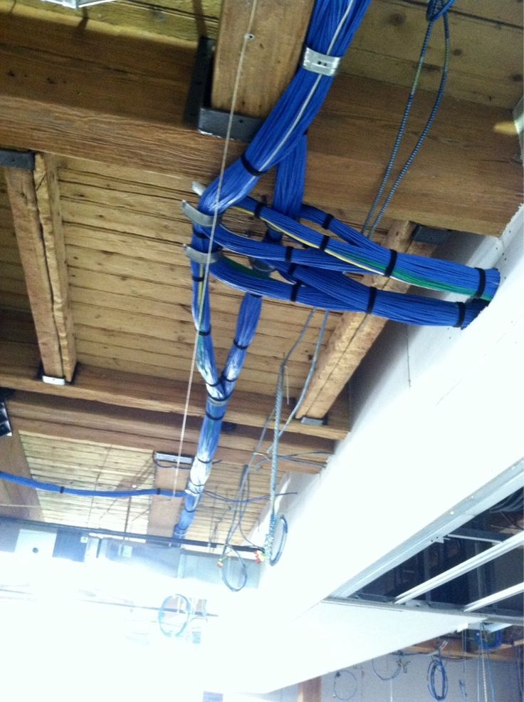 interesting cable management running along the ceiling