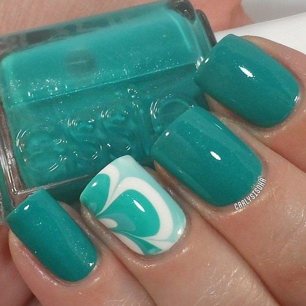 "If you use the terminology of the fashion industry, turquoise became ""the new black"" in the nail-art of the year 2015. Almost all the leading manufacturers of paints included collection of variations on turquoise: bright, pastel, Matt, glossy, with a holographic effect. Marble nails on one or more fingers are excellent variant of usage of this color. The perfect companions for the ""stormy sea"" color are a delicate mint and alpine white."
