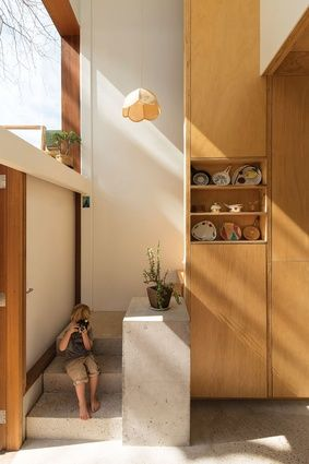3x2 House, Atelier Bow-Wow // A concrete stair and plinth give the small staircase a grand entrance.