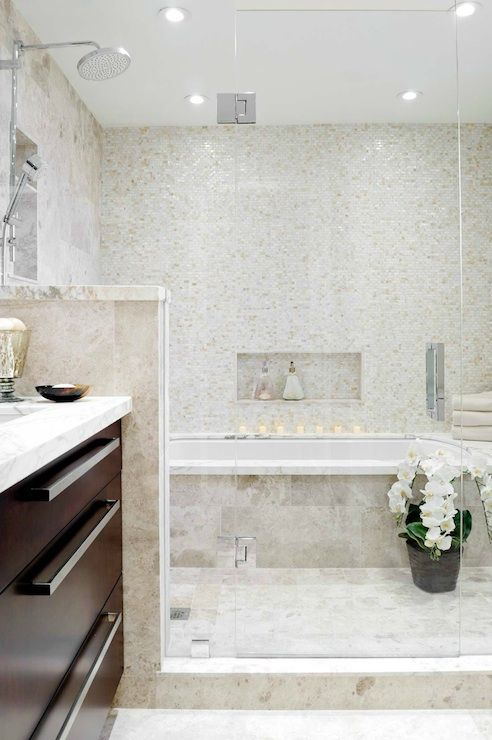 Kelly Stoneburgh Interiors - Seamless glass shower with glass mosaic tiles backsplash, travertine tiles, orchid and rain shower head.