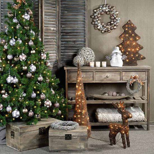 Add the feeling of home and comfort into your home using wood and twigs. Play along with the brown hue by decorating your Christmas tree with pure silver balls and silver wreaths.