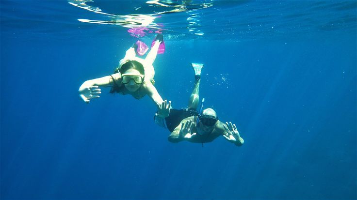 snorkeling at the beautiful cave of Dassia island near Skopelos