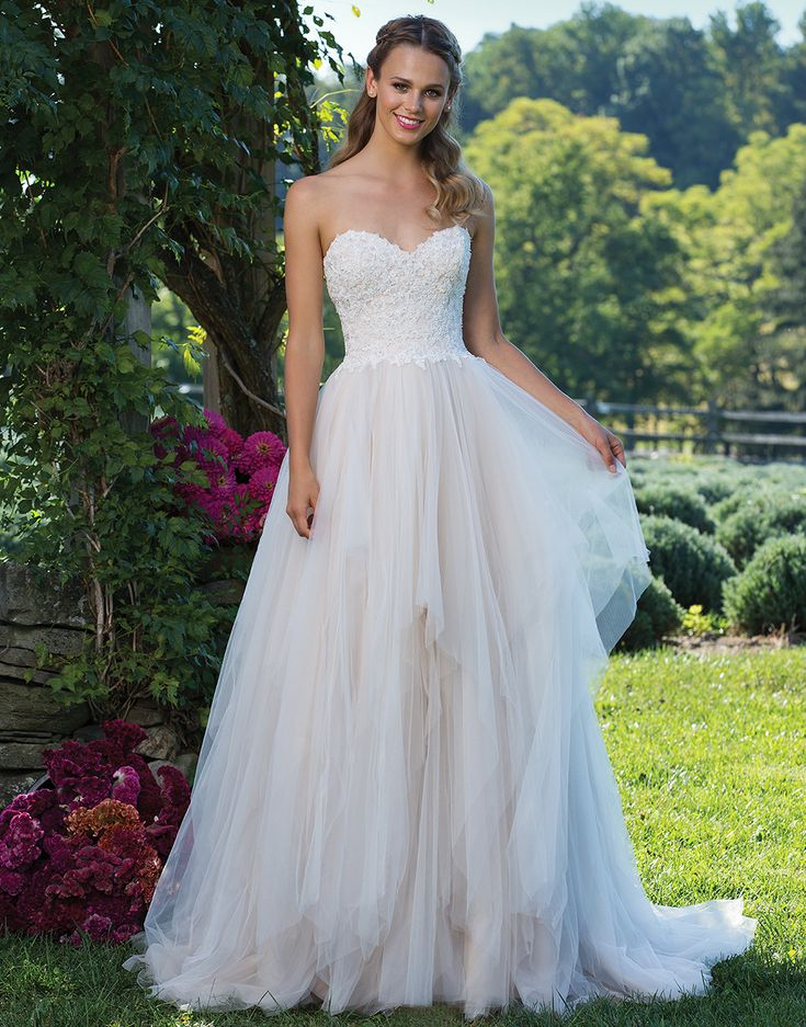 Sincerity Bridal 3974 Vintage Rose/Ivory Size 18 Look like a princess in this ball gown with a sweetheart neckline with beaded lace appliques. The full tulle skirt has added interest and movement from its handkerchief styled layers. https://www.sinceritybridal.com/wedding_dress/3974