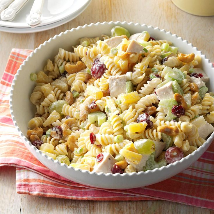 Cashew-Chicken Rotini Salad Recipe -I've tried many chicken salad recipes over the years, but this is my very favorite. It's fresh, fruity and refreshing, and the cashews add wonderful crunch. Every time I serve it at a potluck or picnic, I get rave reviews…and always come home with an empty bowl! —Kara Cook, Elk Ridge, Utah