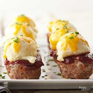 A ho-hum weeknight recipe turns into a cute dinner display when you top mini meatloaves with a sweet cranberry-tomato sauce, creamy mashed potatoes and melty cheese.