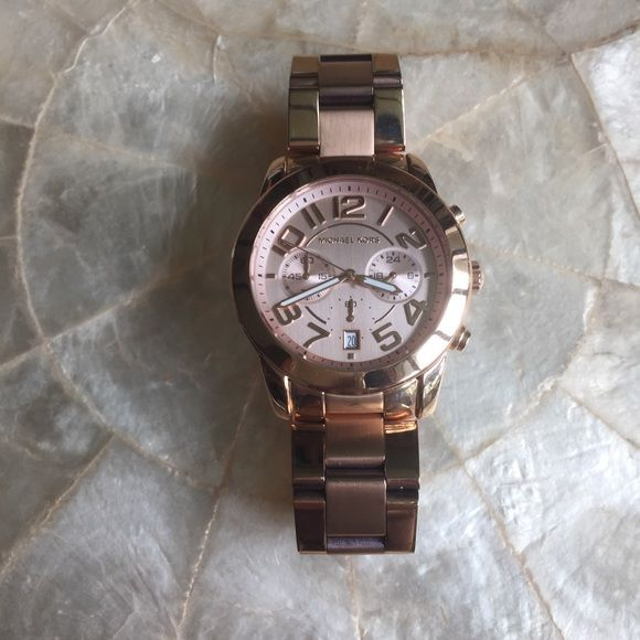 Michael Kors Mercer Ladies Rose Gold Watch 100% authentic Michael Kors Mercer chronograph ladies rose gold watch. MK5727. Rose gold face. Luminescent hands. Date display at 6 o'clock. Quartz movement. 41.5 mm face/case. New in box. Michael Kors Accessories Watches