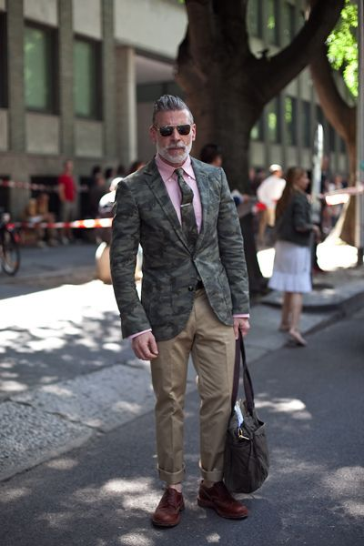 Only Nick Wooster can pull off a camo blazer and tie with pink shirt.